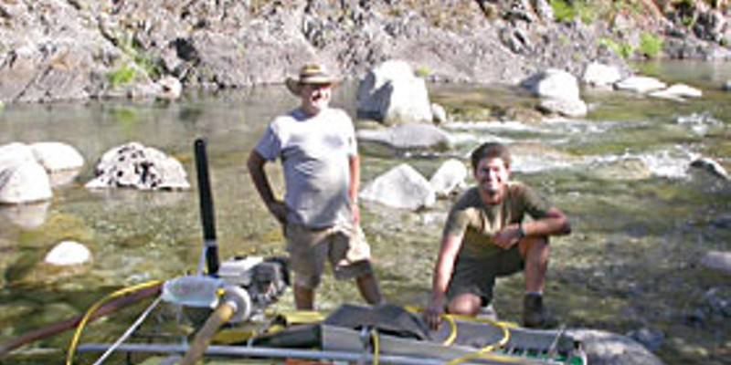 Rock and a Hard Place — Independent gold miners fear extinction as a new wave hits the hills Bill Stanford (left) and his son Chad show off their suction dredge. Photo by Heidi Walters