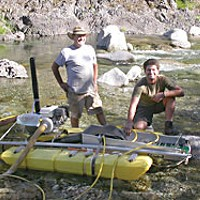 Bill Stanford (left) and his son Chad show off their suction dredge. Photo by Heidi Walters