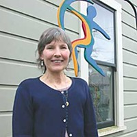Wounded Healers Bonnie Etz in front of the Humboldt Community Breast Health Project.  Photo by Helen Sanderson.