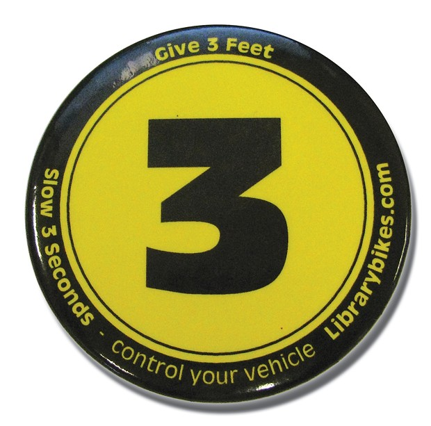Button promoting three feet for safety - PHOTO BY HOLLY HARVEY