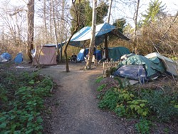 "PHOTO BY RYAN BURNS - ""Camp Happy,"" home to Dave, Steve, Robert and anyone who cares to join them."