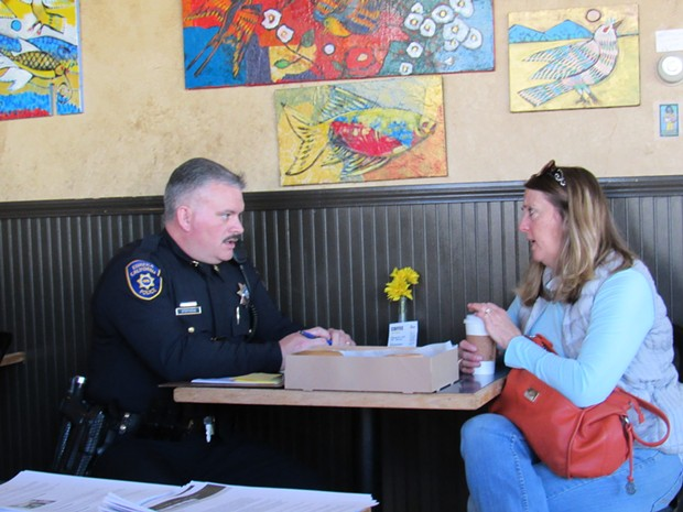 Capt. Brian Stevens of the Eureka Police Department takes notes. - LINDA STANSBERRY