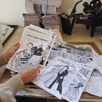 Jack Mays Photos Caroline Titus, editor of The Ferndale Enterprise, with a pile of Jack Mays' editorial cartoons. Photo courtesy The Ferndale Enterprise/Caroline Titus
