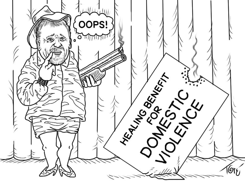 "Cartoon of county supervisor Rex Bohn holding shotgun next to a sign reading ""Healing Benefit for Domestic Violence."""