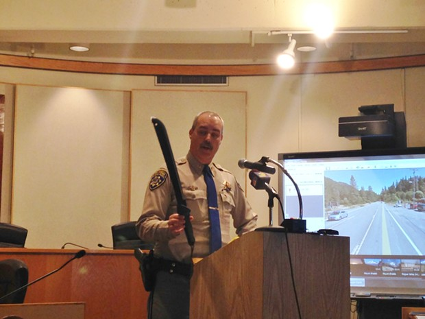 California Highway Patrol Capt. Adam Jager holds a machete similar to the one officials say a 17-year-old suspect used to attack an officer yesterday, leading to a fatal shooting. - THADEUS GREENSON