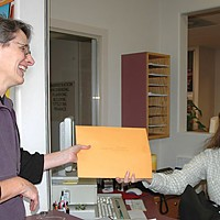 Taking on City Hall City Account Clerk Karen Koskinen hands Janelle Egger the documents she'd sued for. Photo by S.K. Campbell