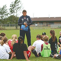 Soccer Dreams Coach Yves Lledo goes over some points with the students. Photo by Bob Doran