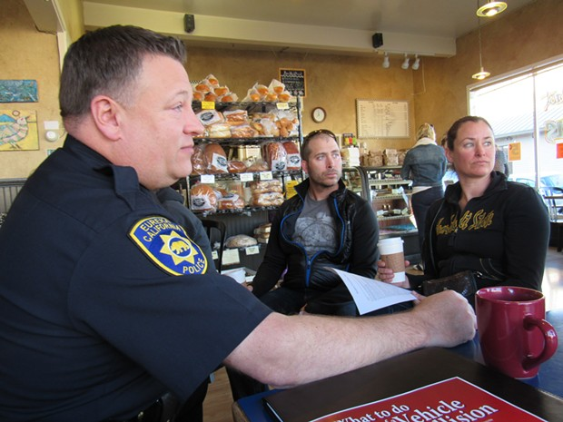 Capt. Steve Watson sits with Todd and Tanya Hudy at Vellutini Bakery. - LINDA STANSBERRY
