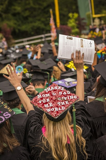 Communication major Allie Phinney had a message for her parents from San Diego on her mortarboard hat. - MARK LARSON