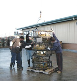 PHOTO BY JENNIFER FUMIKO CAHILL. - Crews Preparing crab pots for loading.