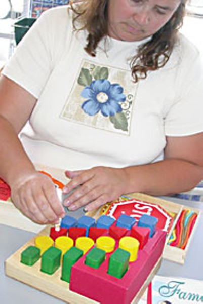 Dawn Craghead at Moon's Play & Learn in Eureka tests toys for the presence of lead. Photo By Heidi Walters
