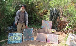 "PHOTO BY LINDA STANSBERRY - Dawson ""Roadie"" Phillip stands in front of his home and studio."