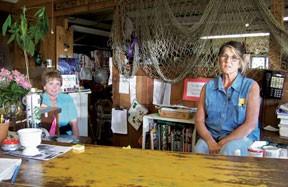 Debbie Jernigan, left, and Kathy Sherwood in the final days of Sherwood Forest Nursery & Florist. Photo by Heidi Walters.