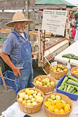 Denis Potter at the Farmers' Market. Photo by Bob Doran.