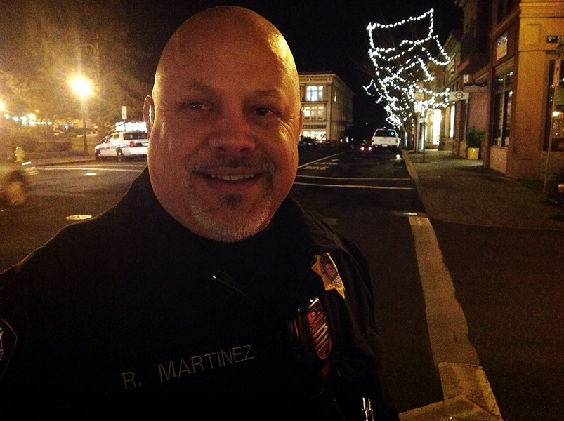 Detective (and Dr. Squid drummer) Bob Martinez patrols the Arcata Plaza and vicinity Friday night, mostly giving warnings to cigarette smokers. - PHOTO BY BOB DORAN
