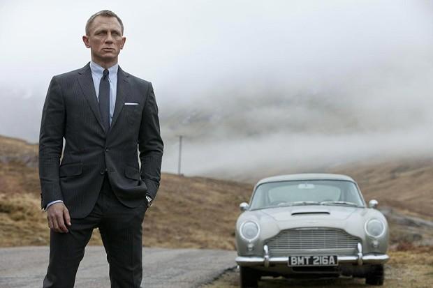 Digging out change for the meter - Daniel Craig as Bond, James Bond