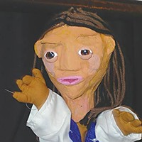 """Dr. Ring's Single-Payer Puppet Show Dr. Maria, star of """"The Sound Of Moolah."""" Photo by Hank Sims"""