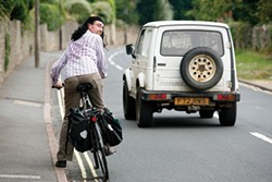 PHOTO COURTESY OF UNIVERSITY OF BATH - Drivers gave U.K. cycling researcher Ian Walker extra clearance when he wore a wig.