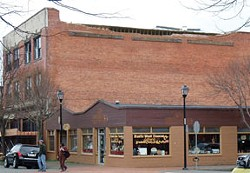 East wall of The Old Town Bar and Grill building, showing the missing parapet. Author Photo