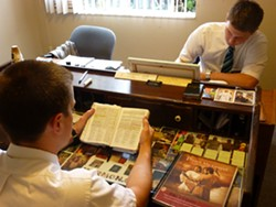 PHOTO BY SCOTTIE LEE MEYERS - Elder Mitchell Camper and Elder Cory Goynes during their morning study.