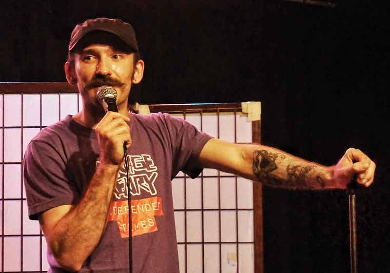 "Emcee Joe ""Moustache"" Deschaine kicks off the Third Annual Savage Henry Comedy Festival telling a few jokes at Humboldt Brews Thursday, Aug. 28, before handing the mic to a collection of comics from near and far. - PHOTO BY BOB DORAN"