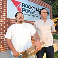 Mission to Omaha En route to Omaha, Yurok Tribal members Frankie Myers and Bob McConnell stand in front of the PacifiCorp business offices outside of Salt Lake City. Photo by Matt Mais/Yurok Tribe.