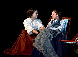 Essie Bertain as Jo and Jessica Malone as Beth in the Humboldt Light Opera production of Little Women (The Musical) at the College of the Redwoods.