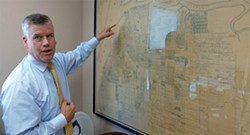 PHOTO BY RYAN BURNS - Eureka attorney Bill Barnum talks about his 1938 map of Eureka created by J.N. Lentell.