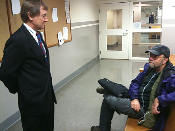 Eureka attorney Paul Hagen and Arcata Eye editor Kevin Hoover talk at the Eureka Courthouse. Photo by Hank Sims