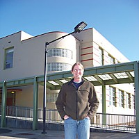 Humboldt Depression Eureka High history teacher Craig Parker in front of the industrial arts building that the Public Works Administration helped build. Photo by Heidi Walters