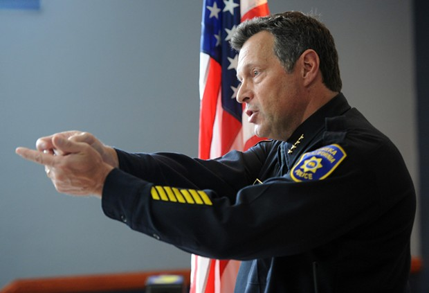 "Eureka Police Chief Andy Mills demonstrates how an officer would be holding their weapon while in the ""high and ready"" position during a press conference on the officer involved shooting of Tommy McCain. - MARK MCKENNA"