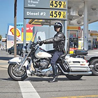 Keep Upright! Eureka Police Department traffic enforcement officer Gary Whitmer patrols the streets of Eureka on his Police Harley-Davidson.  Photo by Mark McKenna