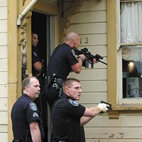 Conflicting Reports Eureka Police officers search for a wanted parolee. Photo by Thadeus Greenson