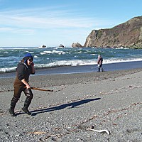 Love Me, I'm a Lamprey Even eeling can't get in the way of an important phone call. The lamprey that Cliff Moorehead's just hooked lies on the beach in front of him. Photo by Heidi Walters