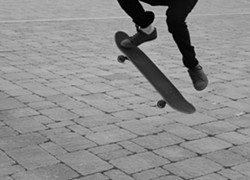 "PHOTO BY ROSE LILY LEVY - ""Evening Kickflip in Old Town."""