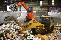 PHOTO BY DREW HYLAND. - Excavators at Humboldt Waste Management Authority's transfer station tops off a trailer with about 16 tons of recyclables. It will travel 142 miles south to be processed at Solid Waste of Willits.
