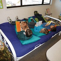 Charter School Rift Fifth and sixth graders lounge on a futon in a portable classroom. Photo by Ryan Burns