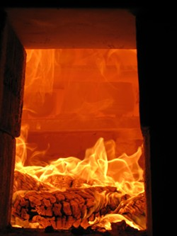 PHOTO BY JASON MARAK - Fire in the kiln