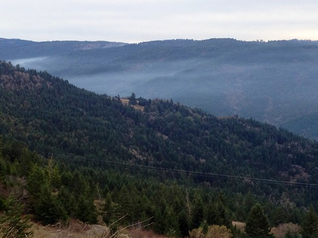 SMOKE FROM THE RED FIRE SETTLES INTO THE VALLEYS.