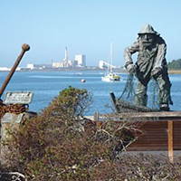 The Top 10 Stories of 2009 Fisherman memorial and defunct pulp mill on Humboldt Bay. Photo by Ryan Burns