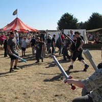 Going Medieval Foam swords clash in the boffer wars. Photo by Laura Dodd