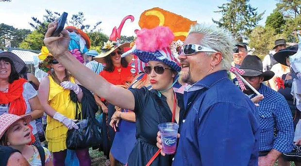 Food Network superstar Guy Fieri poses for a selfie with Kate Walstead Hutchings, one of his duties as guest emcee of Ladies Hat Day, Saturday afternoon, Aug. 23, at the Humboldt County Fair in Ferndale. - PHOTO BY BOB DORAN