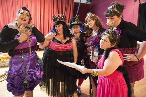 Former queens review the scores of contestants before crowning the 2015 Kinetic Grand Championship Queen. - MARK MCKENNA