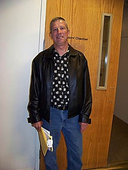 Fortuna resident Charles Simpson stands outside the Board of Supervisors' chambers after appealing to have his property taxes reduced. Photo by Ryan Burns