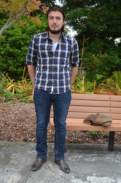 Frenchman Thomas is taking African studies and blending into his new environment with a plaid shirt, jeans and classic black boots. - PHOTO BY SHARON RUCHTE