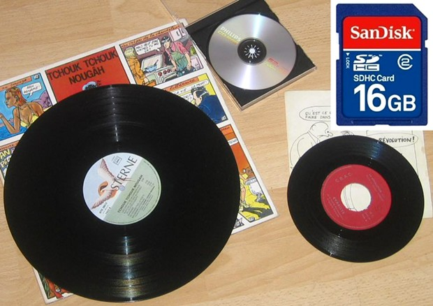 From analog to digital: Introduced in 1949, standard 7-inch 45 rpm vinyl disk has one 3-minute song per side, while 12-inch 33 rpm record holds about 60 minutes/20 songs. 74-minute CD holds 25 songs uncompressed/200 compressed songs. 16 GB chip can store - WIKIMEDIA COMMONS