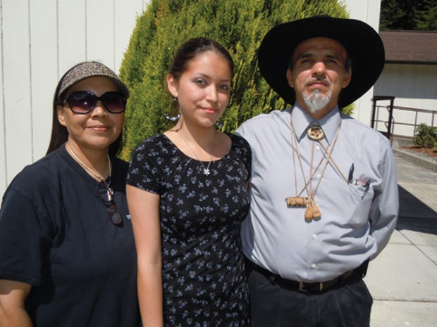 Gayle Norris, left; her daughter Jamyelynn, 19, a traditional dancer; and Yurok Tribe Chairman Thomas O'Rourke Sr. at the ceremony to welcome back ceremonial items. - PHOTO BY HEIDI WALTERS