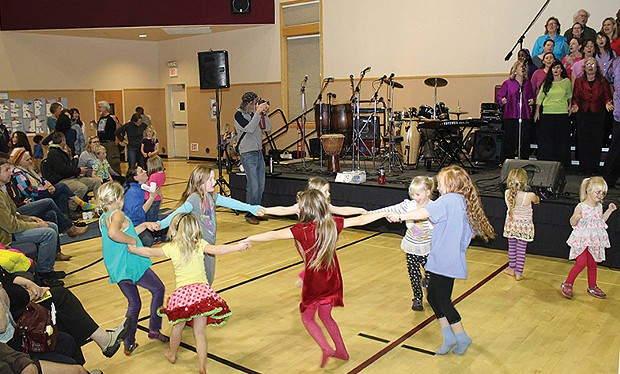 Girls dance a circle dance to music by the Arcata Interfaith Gospel Choir at the annual Bowl of Beans dinner in honor of Martin Luther King Jr. - PHOTO BY BOB DORAN