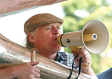 Glasnost Family Holiday music director Gregg Moore announces a tune by Bandemonium at the Humboldt Folk Life Festival. Photo by Bob Doran