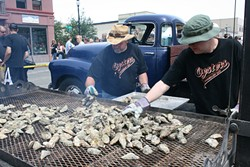 PHOTO BY BOB DORAN - Grilling for the hungry hordes at the Oyster Festival.